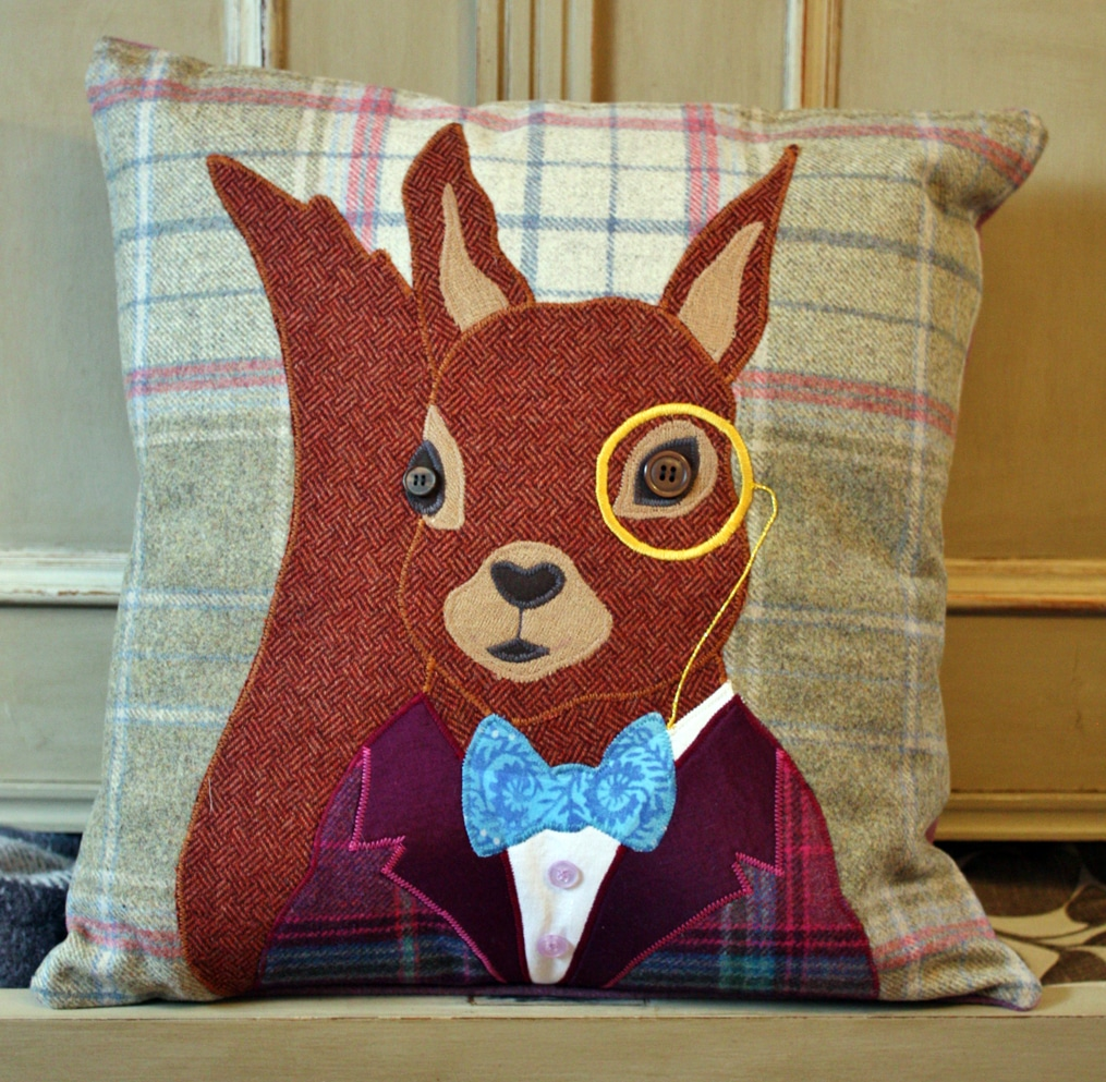 Red squirrel tweed cushion by Alexandra Stevens for The Cotswold Tailor